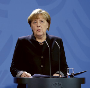 German Chancellor Angela Merkel speaks during a statement at the chancellery in Berlin, Germany, Tuesday, Dec. 20, 2016 the day after a truck ran into a crowded Christmas market and killed several people. (AP Photo/Michael Sohn)