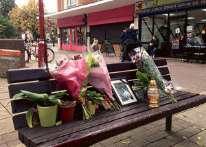 """In this photo taken on Thursday, Oct. 20, 2016, flowers and candles are seen in a memorial to Arkadiusz Jozwik in Harlow, England. On Aug. 27, Arkadiusz Jozwik, known as Arek, was involved in an altercation with youths outside a pizza parlor in Harlow, about 20 miles (32 kilometers) north of London. The 40-year-old was felled by a single punch, hit his head and died in hospital two days later. Police said they were investigating the death as a hate crime, and arrested six teens aged 15 and 16. Poland's ambassador to Britain, Arkady Rzegocki, said he was """"shocked and deeply concerned"""" by the hostility toward the Polish community. (AP Photo/Jill Lawless)"""