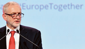 Britain's Labour Party leader Jeremy Corbyn speeches prior to a meeting of European Socialists prior to an EU summit in Brussels on Thursday, Oct. 19, 2017. European Union leaders are gathering for a two day summit to discuss migration, digital economy and Brexit. (AP Photo/Geert Vanden Wijngaert)