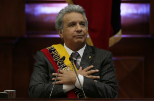 Ecuador's President Lenin Moreno delivers his first, annual state-of-the-nation address inside the National Assembly in Quito, Ecuador, Thursday, May 24, 2018. The first year of Moreno's administration has been marked by the ongoing political feud with his predecessor Rafael Correa. (AP Photo/Dolores Ochoa)